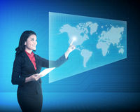Asian business woman touching world on virtual screen Stock Photo