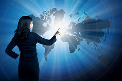Asian business woman touching world on virtual screen Royalty Free Stock Photos