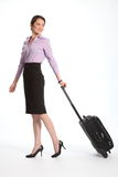 Asian business woman travelling with suitcase Stock Image