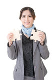 Asian business woman with two pieces of puzzle Royalty Free Stock Images