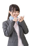 Asian business woman type on cell phone Stock Photos