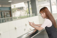 Asian business woman use her cell phone Royalty Free Stock Image