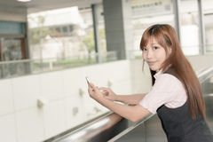 Asian business woman use her cell phone Royalty Free Stock Photography