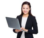 Asian business woman use portable computer Stock Photos
