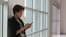Asian business woman use smart-phone stock footage