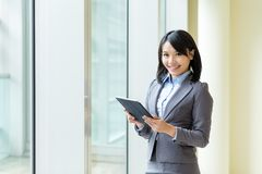 Asian business woman use of tablet computer Royalty Free Stock Photos