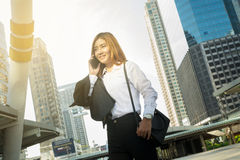 Asian Business Woman use Wireless Smartphone Royalty Free Stock Photos
