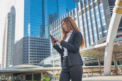 Asian Business Woman use Wireless Smartphone Stock Photography