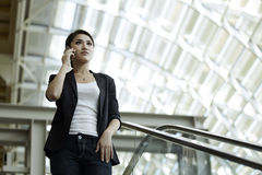 Asian Business woman using a Cell Phone Stock Photography