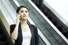 Asian Business woman using a Cell Phone Royalty Free Stock Photos