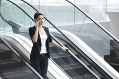 Asian Business woman using a Cell Phone Royalty Free Stock Photo