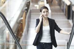Asian Business woman using a Cell Phone Stock Photo
