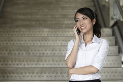 Asian Business woman using a Cell Phone Stock Photos