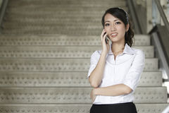 Asian Business woman using a Cell Phone Royalty Free Stock Images