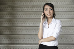 Asian Business woman using a Cell Phone Stock Image