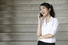 Asian Business woman using a Cell Phone Stock Images