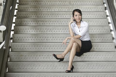 Asian Business woman using a Cell Phone Royalty Free Stock Image