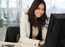 Asian business woman using a computer Royalty Free Stock Images