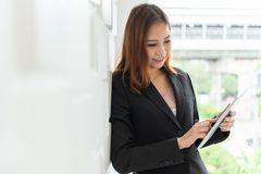 Asian business woman using digital tablet. stock photos