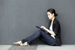 Asian Business woman using an iPad Stock Photos