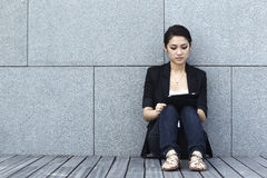 Asian Business woman using an iPad Stock Photo