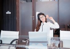 An Asian business woman using laptop in office royalty free stock photo