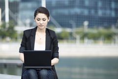 Asian Business woman using a Laptop outside Stock Photos