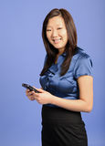 Asian business woman using a PDA Stock Photo