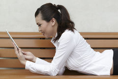 Asian Business woman using a Touch-Pad PC Stock Image