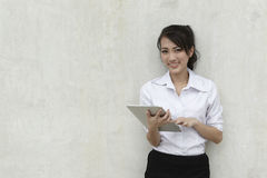 Asian Business woman using a Touch-Pad PC Royalty Free Stock Photos