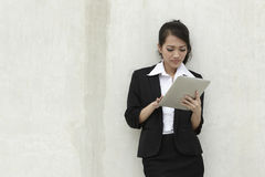 Asian Business woman using a Touch-Pad PC Stock Photos
