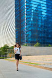 Asian business woman walking cellphone Royalty Free Stock Image