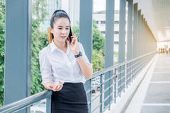 Asian business woman wearing  white shirt talking smartphone for. Work Stock Images
