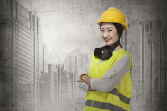 Asian business woman wearing yellow helmet smile Royalty Free Stock Image