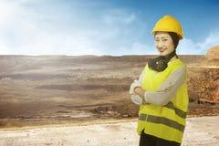 Asian business woman wearing yellow helmet smile Stock Photos