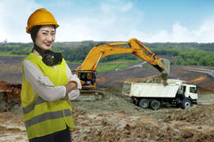 Asian business woman wearing yellow helmet smile Royalty Free Stock Photo