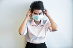 Business woman wear hygiene mask and sick. Asian business woman wears a green hygiene mask and feels sick Royalty Free Stock Image