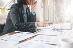 Asian business woman. Working and analysis graph and chart on table with computer notebook Royalty Free Stock Photography
