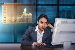 Asian business woman working with computer with virtual market c Stock Photos