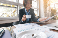 Asian Business woman working. And discusion for analysis chart and graph with decision making Stock Image