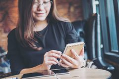 Asian business woman working , holding notebook and using calculator in office Royalty Free Stock Photography