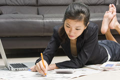 Asian business woman working from home Royalty Free Stock Images