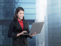 Asian business woman working with laptop Stock Photos