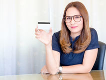 Asian business Woman working in office. and show the Credit Cards. Financial of Women, concept. Asian business Woman working in office. and show the Credit Stock Image