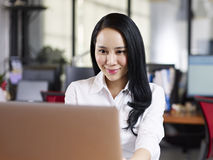 Asian business woman working in office Stock Image