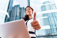 Asian business woman working outside on computer Stock Image