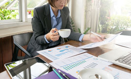 Asian Business woman working. Two Asian Business woman working and discusion for analysis chart and graph with decision making Stock Photos