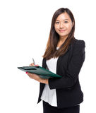 Asian business woman write on clipboard Stock Photos