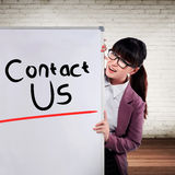 Asian business woman write contact us Royalty Free Stock Images