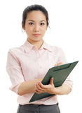 Asian business woman write on file pad Stock Photos